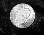 Click here to enlarge image and see more about item 052908001: Morgan Silver Dollar 1887 Uncirculated mint condition 90% silver.