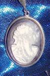 Click here to enlarge image and see more about item 072409041: Shell cameo pendant set in 835 silver frame, 800 silver necklace.