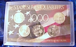 Click here to enlarge image and see more about item 092308005: State Series Quarters 2000-P in patriotic display holder