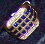 Click here to enlarge image and see more about item 092809001: Man's 14K yellow gold ring w/ 39 square sapphire stones.