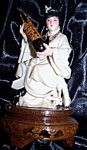 Ivory figurine of seated oriental woman on pedestal