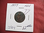 Click here to enlarge image and see more about item 121007008: Indian head penny 1897 with hole in top.