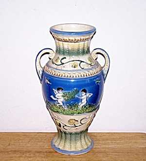 CHERUBS ON GLAZED POTTERY URN VASE (Image1)