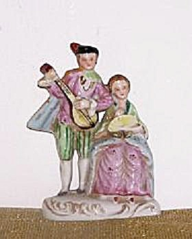 O.J. COLONIAL MAN & WOMAN FIGURINE (Image1)
