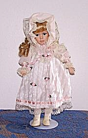 DOLL IN RIBBON DESIGN DRESS (Image1)