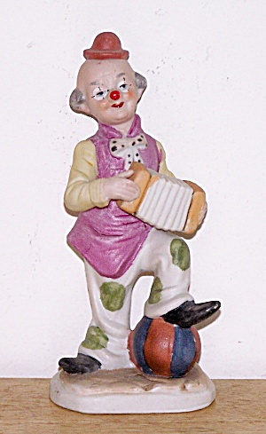 BISQUE CLOWN PLAYING ACCORDION, FOOT ON BALL (Image1)
