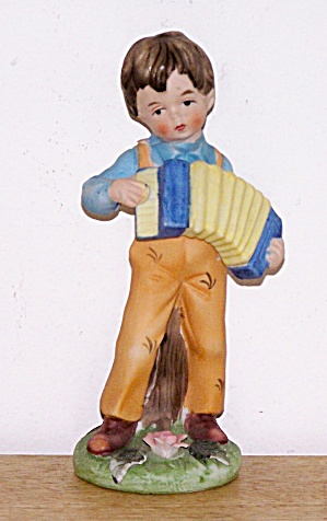 YOUNG LAD PLAYING ACCORDION (Image1)