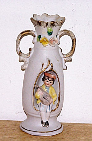 CUT OUT BISQUE VASE, 3-D  SEATED BOY (Image1)