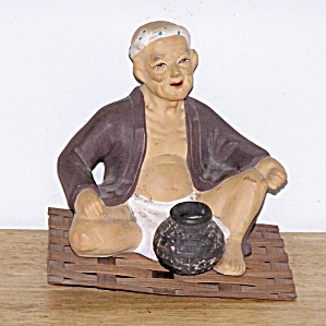 ORIENTAL MAN SITTING ON MAT (Image1)
