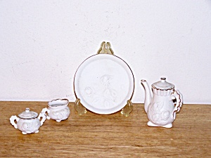 CHILD�S WHITE BISQUE TEA SET (Image1)
