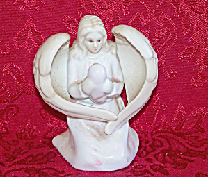 WOMAN Holding BABY Inside a Pair of ANGEL Wings (Image1)