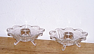 PAIR OF CLEAR GLASS FLOWER SHAPED CANDLESTICKS (Image1)