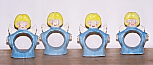 4 PORCELAIN ANGEL NAPKIN RINGS (Image1)