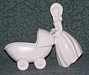 PINK LADY PUSHING BABY CARRIAGE PLANTER (Image1)