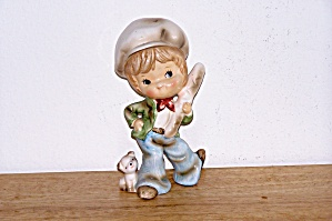 BOY CARRYING LOAF OF BREAD W/ DOG WATCHING FIGURINE (Image1)
