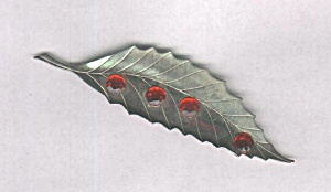 SILVER LEAF PIN W/ 4 RED STONES (Image1)