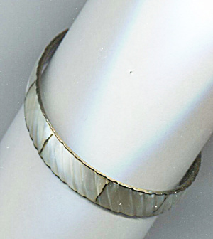 Gold Tone Metal Bracelet Covered In White Sections