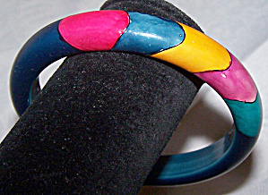 Dark Blue Hard Plastic Bangle With Splashes Of Color