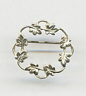 SMALL CIRCLE GOLD TONE PIN W/PRESSED LEAVES (Image1)