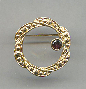 Gold Tone Circle Pin With Ruby Glass Stone