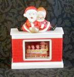 Click here to enlarge image and see more about item 3322: MR. & MRS. SANTA CLAUS SNOW DOME