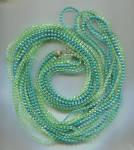 Click here to enlarge image and see more about item 377a: 8 CAPPED STRANDS GREEN PLASTIC ROPE NECKLACE