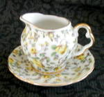 Click here to enlarge image and see more about item 6054: INARCO CREAMER & PLATE, YELLOW CHINTZ