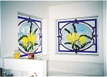 These gorgeous night blooming cereus panels cover the large glass block windows of the bathroom.  The glass block didn't provide as much privacy as desired, and made the room too bright.  The stained glass panels tone down the glare, while still providing a colorfully lit gallery above the jacuzzi tub.  How romantic!