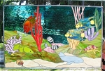 """This gorgeous stained glass panel depicts life on a coral reef off the east coast of Florida.  A pair of queen angelfish, a rainbow parrotfish, a moray eel, a few butterflyfish and a wrasse swim about the reef, while a nurse shark rests in the sand.  Don't miss the hermit crab crawling along the bottm.  Can you find the razorfish peeking out of his hole?  This wonderful panel measures 30-3/4"""" x 48-3/4"""", including the zinc framing.  For an additional $150, the panel can be framed in solid oak.  This panel can be delivered within a 100-mile radius of my Palm Bay, Florida location.  Outside of this area, you must make arrangements to pick it up."""