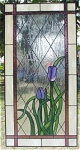 This wonderful panel measures 18 x 24 and displays 2 tulips blooming outside a window.  The backgroud glass is called open chip.  It has a beautiful texture that adds class to the panel, and also provides a degree of privacy.
