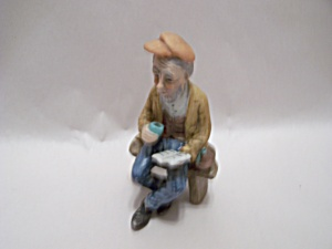 Grandfather Reading On A Bench Figurine