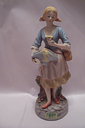 Porcelain Young Woman With Flower Basket Figurine (Image1)
