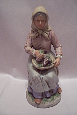 Porcelain Grandmother With Vegetable Basket Figurine