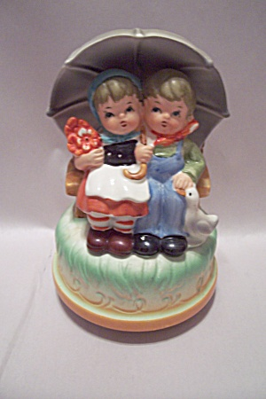 Porcelain Boy & Girl Under Umbrella Music Box