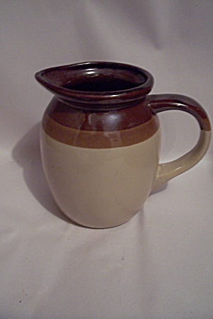 Brown Trimmed Tan Pottery Pitcher