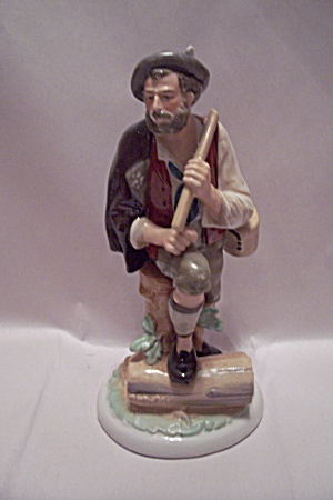 Porcelain German Wood Chopper Figurine