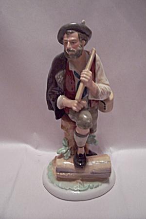 Porcelain German Wood Chopper Figurine (Image1)