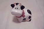 Click here to enlarge image and see more about item BG00656: Holstein Cow Pepper Shaker