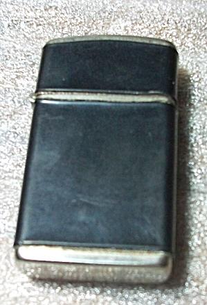 1970`S CHAMP TRIMLITE LADIES BLACK WRAP LIGHTER (Image1)