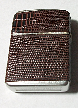 NOS NEW STORM KING FAUX BROWN SKIN LIGHTER (Image1)