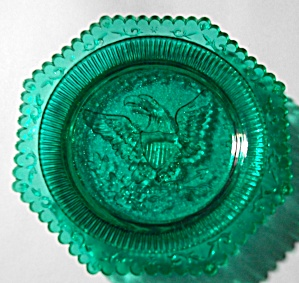 VINTAGE EMBOSSED GREEN AMERICAN EAGLE CUP PLATE (Image1)