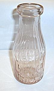 VINTAGE PINK LIBERTY MILK CO. BUFFALO N.Y. MILK BOTTLE (Image1)