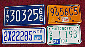 4 OLD DIFFERENT  MOTORCYCLE PLATES FROM USA (Image1)