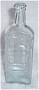 EMBOSSED HOODS SARSA PARILLA APOTHECARIES BOTTLE (Image1)