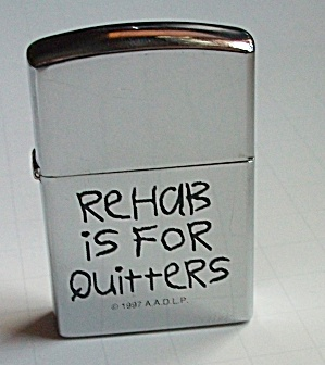 A.A.D.L.P. REHAB IS FOR QUITTERS POCKET LIGHTER (Image1)