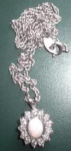 AVON  MOTHER OF PEARL STYLE WITH FAUX DIAMOND (Image1)