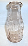 Click here to enlarge image and see more about item 7040802: VINTAGE PINK LIBERTY MILK CO. BUFFALO N.Y. MILK BOTTLE