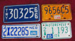 4 OLD DIFFERENT  MOTORCYCLE PLATES FROM USA