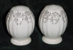 Click here to enlarge image and see more about item W227: VINTAGE SALT AND PEPPER SHAKERS