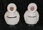 Click here to enlarge image and see more about item W233: ESKIMO SALT AND PEPPER SHAKERS